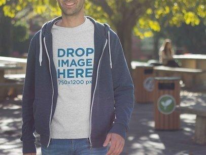 T-Shirt Mockup of a Young Man at a University a8690