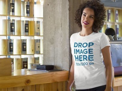 T-Shirt Mockup Featuring a Pretty Black Woman in a Restaurant a8356