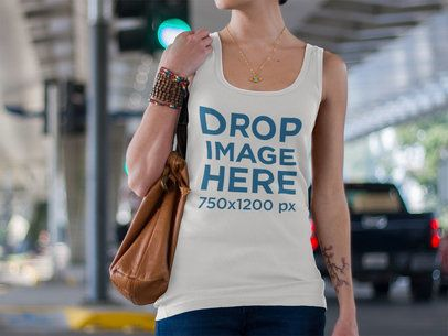 Tank Top Mockup of a Young Woman Walking in the Street a8797