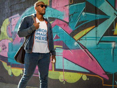 Tee Mockup of a Black Man Walking by a Graffiti Wall a8976