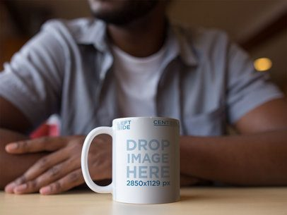 Coffee Cup Mockup of a Man at a Diner a12324