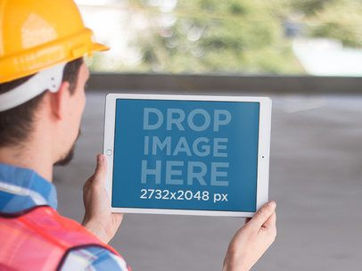 iPad Pro Mockup Held in Landscape Position by a Construction Worker a12431
