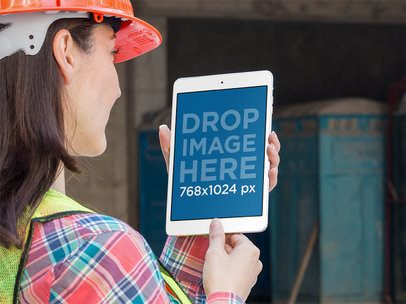 Mockup of a Female Worker Staring at an iPad in Portrait Position 12573