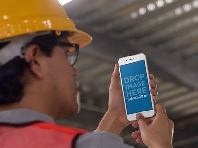 iPhone Mockup in Portrait Position Featuring a Man Inside a Factory 12586