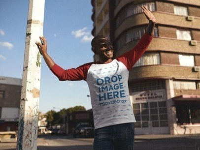 Smiling Young Black Man Looking at the Sun in his Raglan T-Shirt Mockup a12546