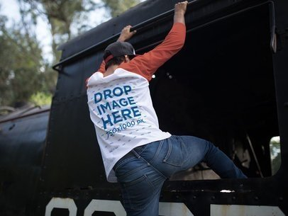 Back Side Raglan T-Shirt Mockup of a Guy Climbing on the Side of a Train a12480