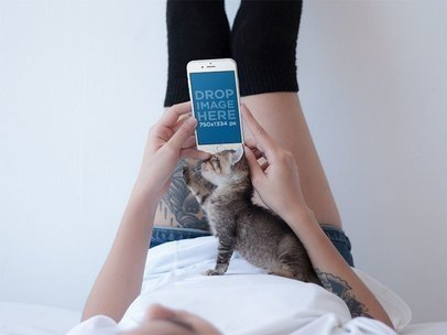 iPhone Mockup in Portrait Position of a Tattooed Woman with a Kitten 12804