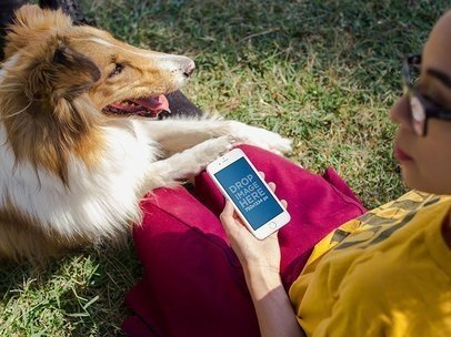 White iPhone 6 Mockup of a Woman Enjoying a Day at the Park with her Dog a12796