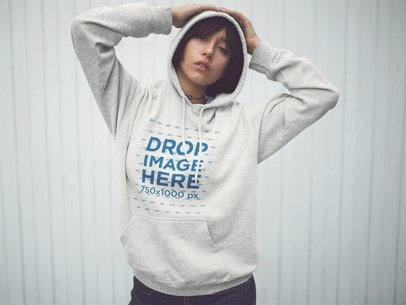 Pullover Hoodie Mockup of a Girl with Short Hair with her Hands on her Head a12660