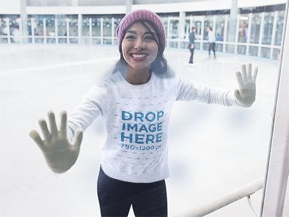 Smiling Girl Skating and Wearing a Crewneck Mockup with a Beanie a13255