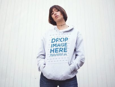 Trendy Asian Woman Wearing a Pullover Hoodie with her Hands in her Pocket a12661