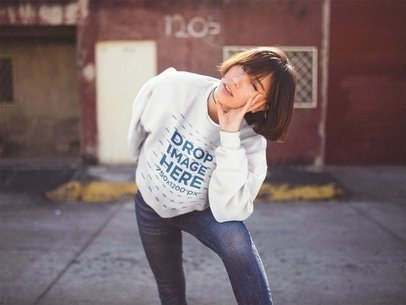 Crewneck Sweatshirt Mockup of a Girl with Short Hair Leaning on her Knee a12672