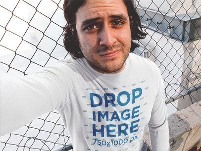 Man with Long Hair Wearing a Long Sleeve Tee and Taking a Selfie Mockup a12907