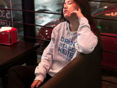 Asian Girl Closing her Eyes at a Late Night Diner Pullover Hoodie Mockup a12697