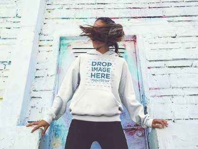 Pullover Hoodie Mockup of a Young Woman Flipping her Hair in the Street a12847