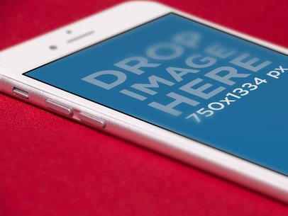 iPhone Angled Close Up Mockup Lying Over a Red Surface a12701