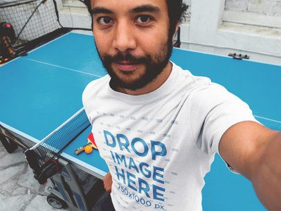 T-Shirt Selfie Mockup of a Young Asian Guy Playing Ping Pong a12921