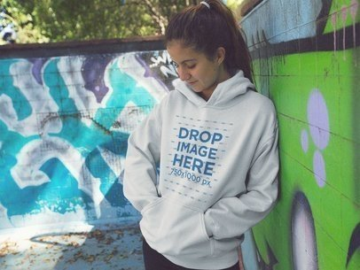 Hoodie Mockup of a Young Woman with a Ponytail Looking Down a12852