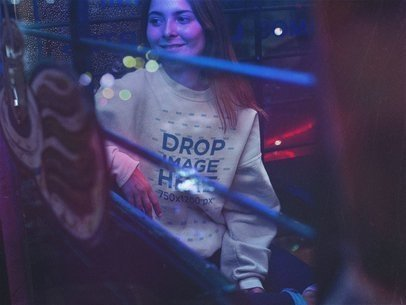 Crewneck Sweatshirt Mockup Featuring a Beautiful Woman Sitting in Neon Lights a12687