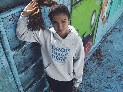 Hoodie Mockup of a Pretty Girl Playing with her Ponytail in an Urban Space a12853
