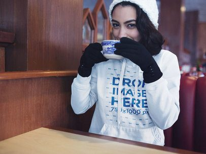 Pullover Hoodie Mockup of a Girl with Gloves Drinking Hot Cocoa Inside a13181