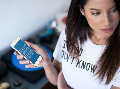 Beautiful Girl Holding A White iPhone 6 On Her Right Hand Mockup a14041