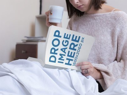 Young Woman Reading a Book While Drinking a Tea in Her Bed Mockup a14300