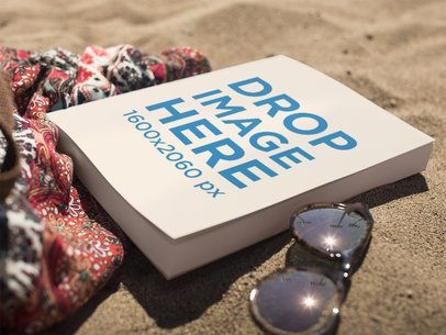 Book Lying on the Beach Near Sunglasses and a Skirt Mockup a14276
