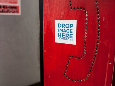 Square Sticker Glued to a Red Phone Booth a14343