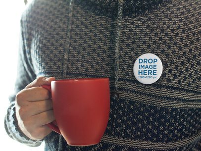 Mockup of a Button on a Man Sweater While Having a Coffee in a Red Mug a14326
