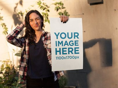 Young Hispanic Girl Winking While Holding a Poster a14460