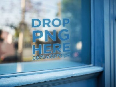 Decal Near the Corner of a Window Surrounded by a Wooden Blue Frame Mockup a14422
