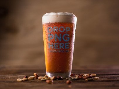 Mockup of a Pint of Red Beer Standing on a Wooden Surface Near Peanuts a14615