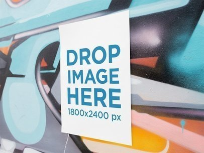 Mockup of a Poster on a Colorful Graffiti Wall a14634