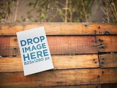 Half Letter Flyer Template on a Wooden Surface Near Plants a14726