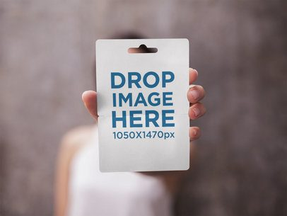 Gift Card Mockup Held by a Girl Against a Blurred Background a14755