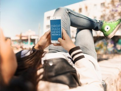 Mockup of a Girl Using her White iPhone 6 While Having a Break at the Skatepark a14703