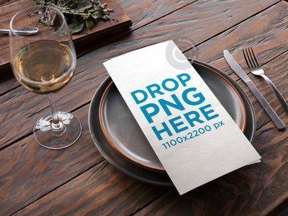Menu Template Lying Over Dishes Near a Glass of White Wine on a Wooden Table a14753