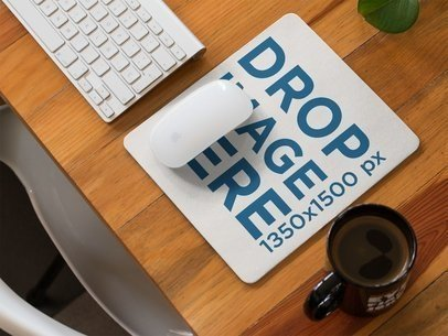 Mousepad Template on a Wooden Desk With a Morning Coffee Beside It a14903