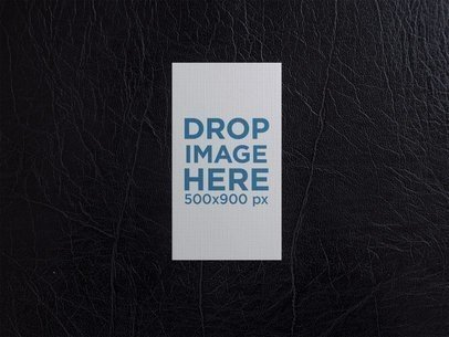 Vertical Business Card Mockup Lying on a Leather Surface a14999
