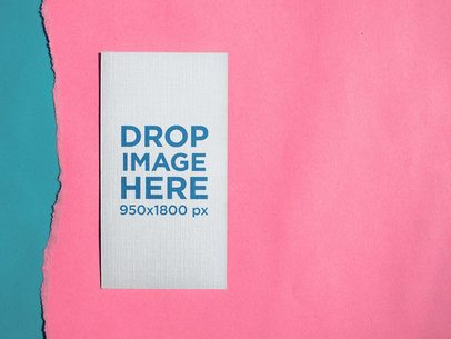 Vertical Business Card Mockup Lying on Pink Ripped Paper a15012