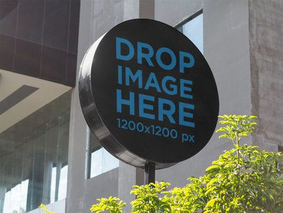 Round Sign Mockup in an Open Mall Outdoors a14972