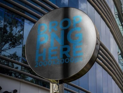 Round Sign Mockup Standing in a Coffee Shop Outside a Mall a14971