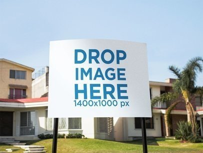Mockup of a Real Estate Lawn Sign in the Front Yard of a House a15014