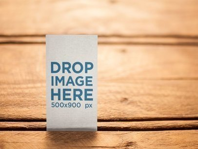 Vertical Business Card Template Standing on a Wooden Surface a15017