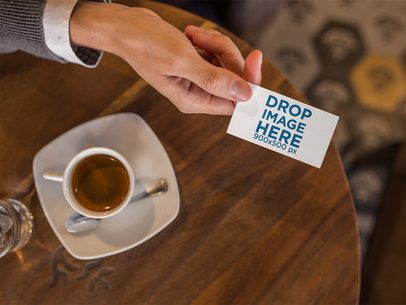 Business Man Handing a Business Card Template While at a Cafe a15029