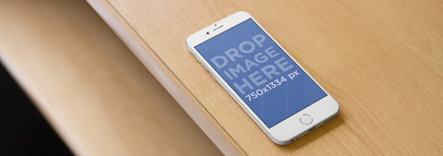 White iPhone 6 Mockup Template at a Creative Office