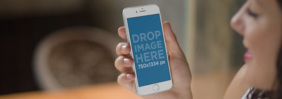 Mockup Template of a Cheerful Woman Using an iPhone a9790