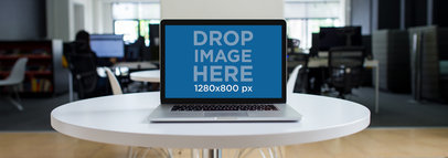 MacBook Pro Mockup on a White Table in a Modern Office a12366
