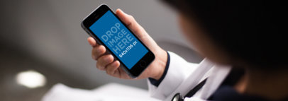Black iPhone 6 Mockup Held by a Doctor in Portrait Position a12312